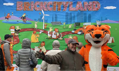 RITchie the Tiger and Leigh Rubin at BrickCityLand Mural unveiling